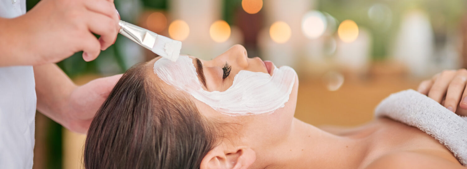 Cropped shot of an attractive young woman getting a facial treatment at a spa